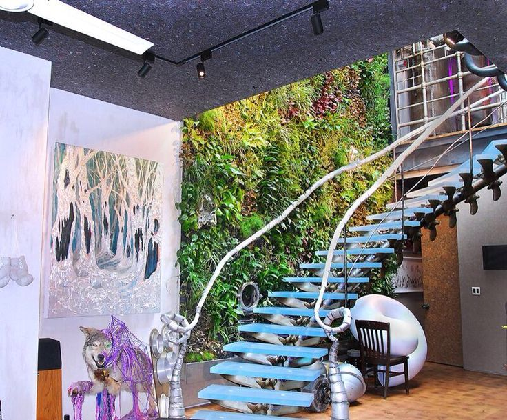 This eccentric garden resides in a unique apartment in the West Village in NYC. The owner used his wonderfully creative touch to add several glass sculptures and a huge flat screen TV!