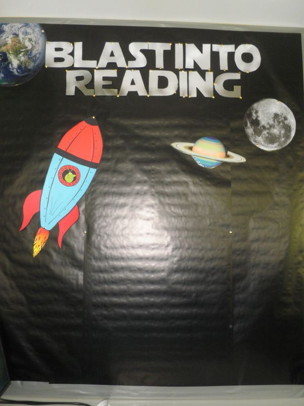 Premier's Reading Challenge Space. Children add a rocket or alien when the finish the PRC