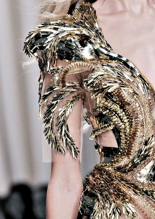 Fashion Gold... luxurious gold dress with an intricately structured, raised pattern; closeup couture; opulent fashion // Valentin Yudashkin