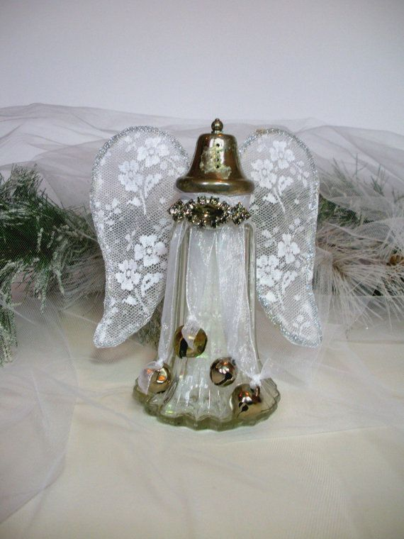 Altered Salt Shaker, 6 Tall Angel with Bells Wings Vintage Brooch and Glitter! They say every time you hear a bell ring another Angel gets their wings! This nearly 6 tall vintage salt shaker has been altered so the bells ring every time you move it. The shaker is filled with iridescent