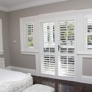 Window and door plantation shutters for the bedroom for Hamptons style window treatments