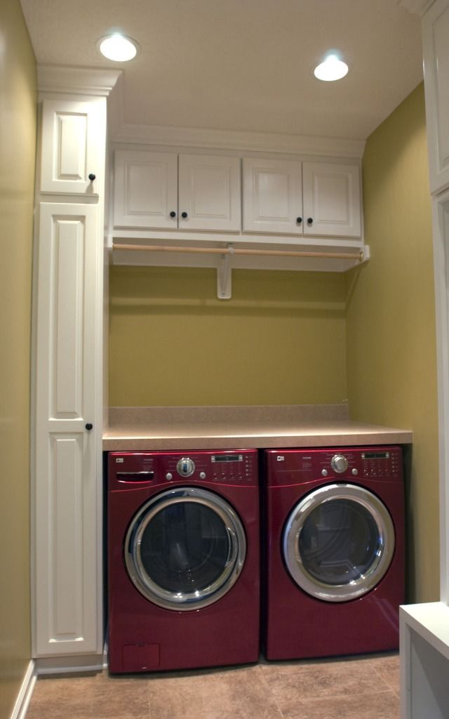 Impressive design for contemporary laundry room with small lamps and red modern washing machine and pastel wall color and small top cabinets Our washer and dryer will have pedestals. But this is nice and clean. We have more width than this pic
