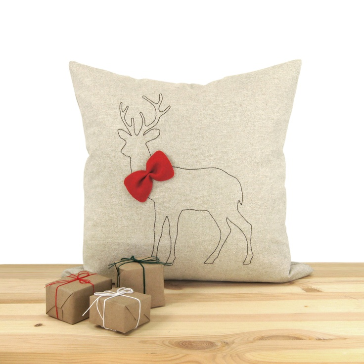 Christmas pillow cover, Holiday home decor, Decorative throw pillow - Brown deer silhouette with red felt bowtie on natural fabric. $34.00, via Etsy.