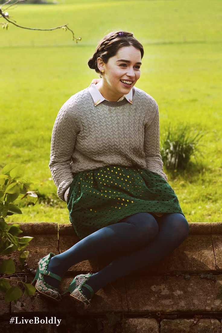 Light green knitted sweater styled with a forest green a line cut-out skirt, blue tights, and unique floral heels. | Me Before You Movie | In Theaters June 3