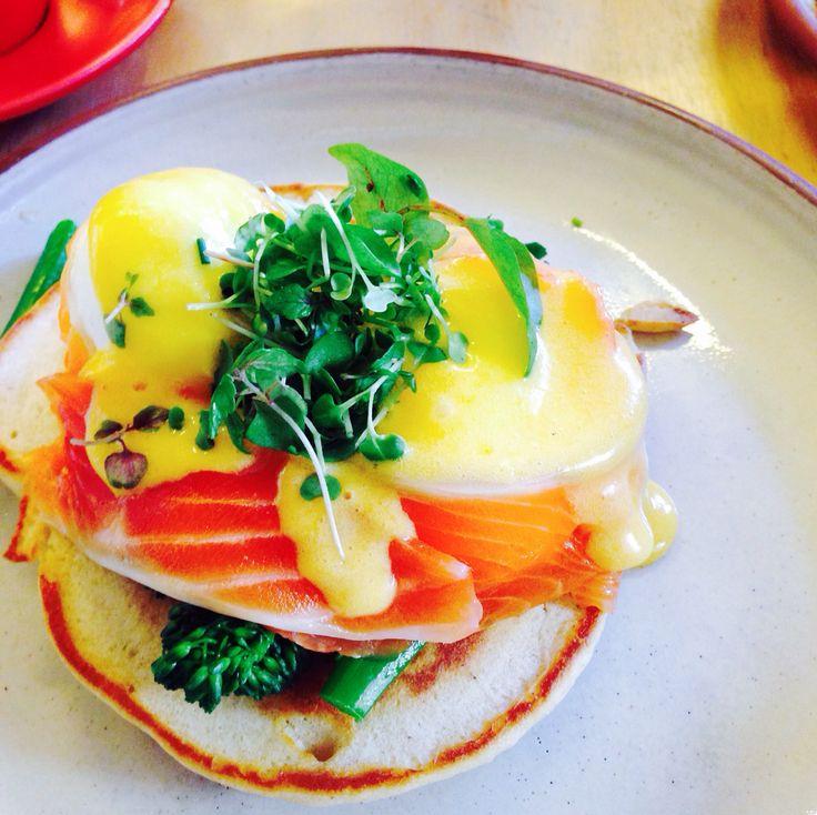 Eggs blini [buckwheat blini, cured king salmon, salmon caviar, brocollini, sauce Mikado and poach eggs]