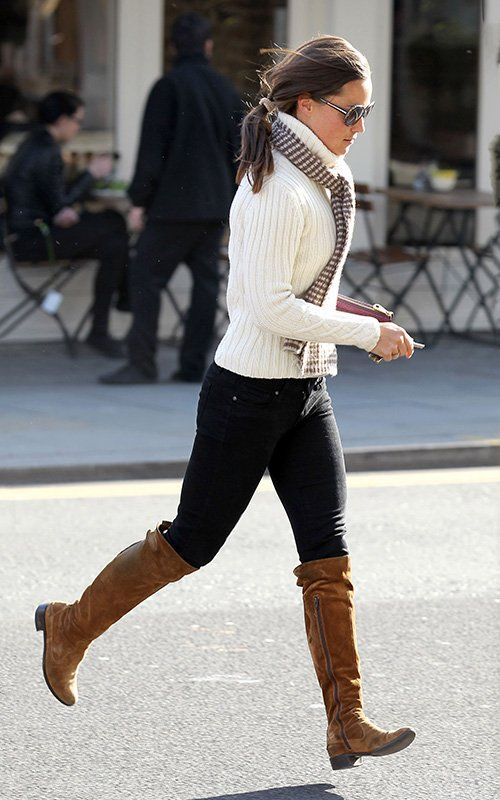 checkered pattern scarf added to cable-knit turtleneck sweater, black skinnies, knee-high brown boots
