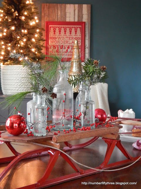 Love this sled centerpiece with bottles and greenery
