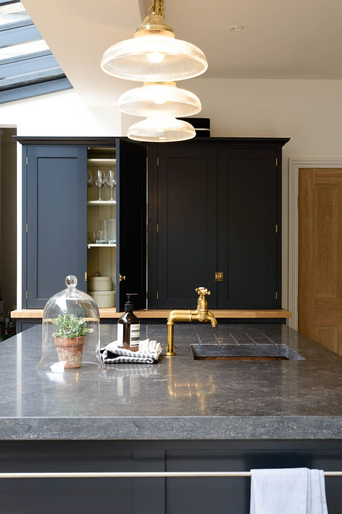 Gorgeous island with Belgian Blue Fossil worktops, our Aged Brass Mayan taps and a hammered copper sink