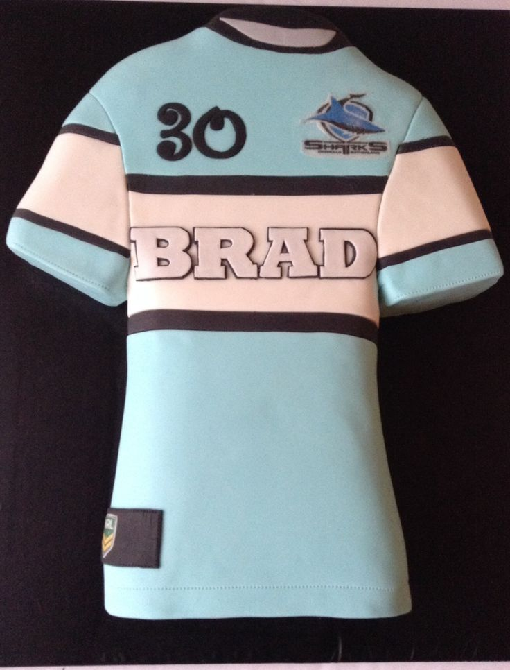 Cronulla Sharks Jersey cake. https://m.facebook.com/pages/Cake-Art-by-Bec/253457001361590?id=253457001361590&_rdr