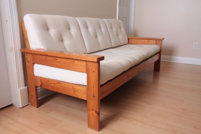 sofa - 3 seat, cream coloured cushions with wood frame. dimensions: 73.5 in (w) x 31 in (h) x 31 in (d) excellent condition, barely used. pick up only.