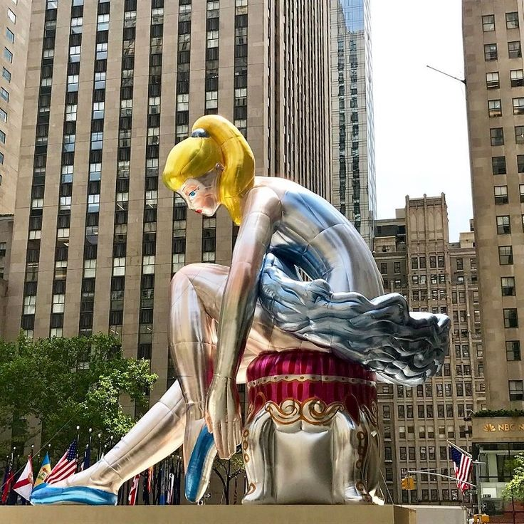 Jeff Koons has created a 45-foot-tall Seated Ballerina sculpture that's currently on display in New York City's Rockefeller Center.