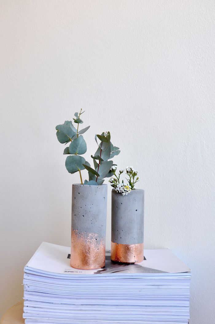 Twin concrete vases finished with copper leaf.