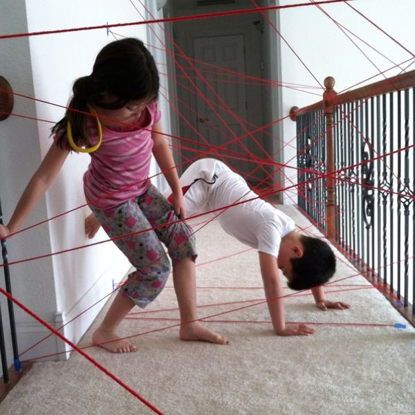 "Yarn and tape a hallway for a ""laser obstacle course"". That will keep 'em busy for a couple of hours.    Great idea for a rainy day!"