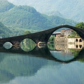 "Devil's Bridge, Lucca, Italy. Ponte della Maddalena (Italian: ""Bridge of Mary Magdalene"") is a bridge crossing the Serchio river near the town of Borgo a Mozzano in the Italian province of Lucca."
