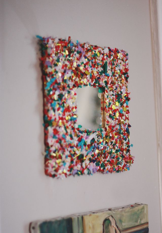 This super easy DIY Confetti Mirror would jazz up any escort card frame or table number