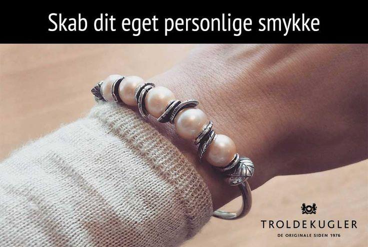 Hos Henrik Ørsnes kan du sammensætte dit personlige smykke med Troldekugler.
