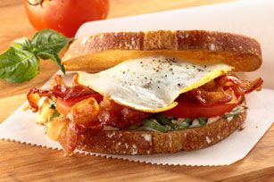 Over-Easy BLT recipe   What You Need         2  slices  OSCAR MAYER Bacon       1   egg          Freshly ground black pepper       2  slices  country white bread, toasted       1  Tbsp.  KRAFT Mayo with Olive Oil Reduced Fat Mayonnaise       1  Tbsp.  thinly sliced fresh basil       2   tomato slices