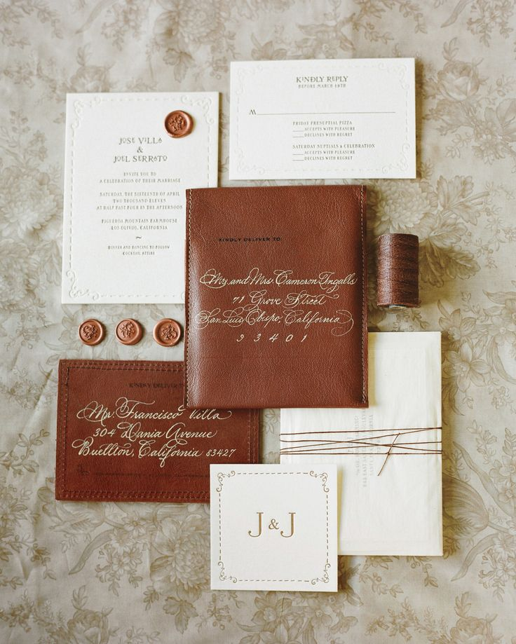 Letterpress invitations from Papel Paper & Press were bound in onionskin paper and twine, mailed in these gorgeous hand-stitched leather envelopes—plus the calligraphy and stamps went right onto the material.