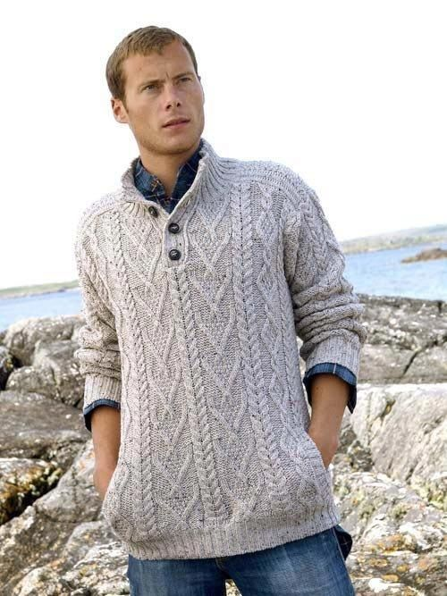 """Made from 100% Soft Merino Wool, this mans shawl collar cable knit sweater is knit using traditional knitting patterns from Ireland. The """"V"""" neck shawl collar is the main feature of this Irish sweater. It is completed with the use of an old style button closure."""