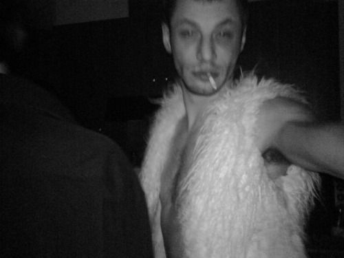 fur vest black and white photo