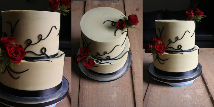 Cake's covered in White Chocolate Ganache with Black fondant swirls & fresh Roses.