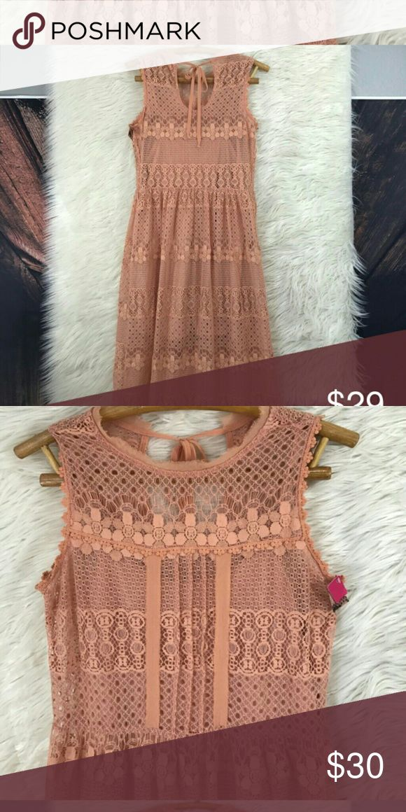 Peach lace dress Gorgeous,  lady like lace. Tie back,  lined to the high thigh, but lace goes to knee. Shoulderless, but great with a cardigan. Perfect condtion,  worn once Xhilaration Dresses Midi