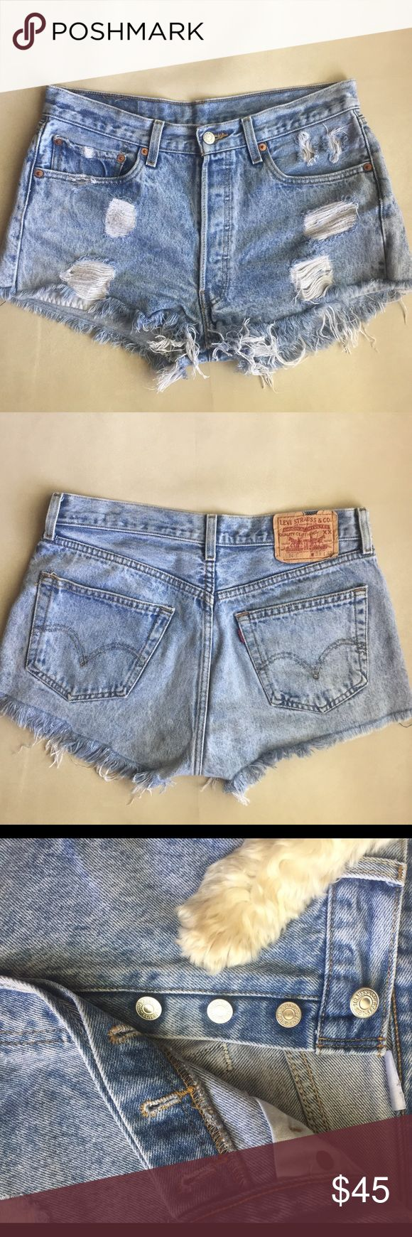 """501 Levi's High Waisted Shorts- Button Fly These deconstructed shorts are perrrrfect for any wardrobe! They're so comfortable and asset enhancing. Last photo is printed on the back of one of the pockets. Ha cute. 14"""" back rise 11.5"""" front rise 31.5"""" Waist 2"""" inseam. 100% cotton! See measurements to ensure fit. Levi's Shorts Jean Shorts"""