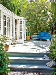 Two set of French Doors open onto a spacious deck, pool, and sprawling gardens. Plants thrive in the Florida climate, creating a private retreat that's enjoyable year-round.