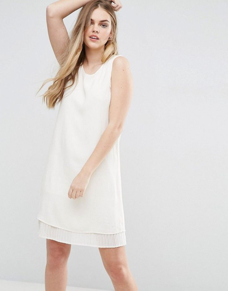 Buy it now. Vila Shift Dress With Pleated Underlay - White. Dress by Vila, Lightweight woven fabric, Round neck, Pleated underlay, Regular fit - true to size, Machine wash, 100% Viscose, Our model wears a UK S/EU S/US XS and is 174cm/5'8.5�. ABOUT VILA Seeking inspiration from street and city style, Danish label Vila combine quality fabrics, textures and delicate cuts to create fashion-forward garments. Intricate feminine detailing and fine prints channel the brand's signature elegant…