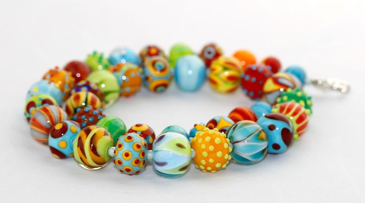 Colorful handmade glass beads in summer mood.