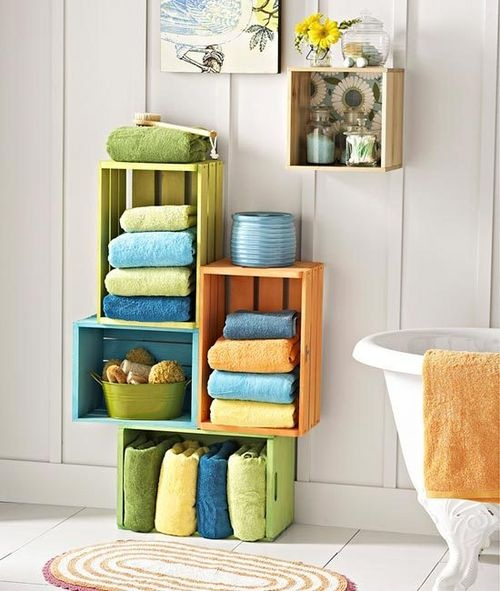 small space storage solutions inexpensive wood crates painted in bright colors bring fresh style to a bathroom multiply the number of crates to create