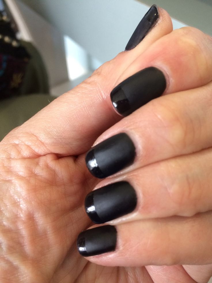 Matte black gel manicure with shiny black tips. This manicure was great, because when the matte finish started to wear off, I took it all off with nail polish remover and got another week out of the nails with them all shiny.