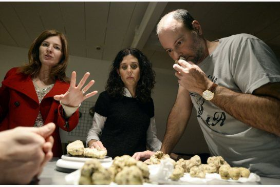 Ashley Madison founder Noel Biderman, with his wife Amanda, samples some truffles supplied by Wanda Srdoc, left, at a dinner prepared by Corey Mintz.