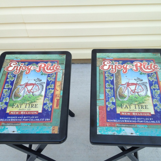 Old wooden tv trays made over w paint and beer advertisement posters