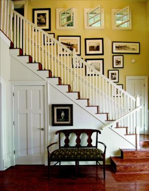 """Cottage style entry hall and staircase. Love the """"portrait gallery"""" along the staircase wall and the white and wood tones together"""