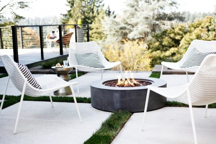 A round Topanga Natural Gas Fire Table is available in two sizes at prices ranging from $2,395 to $3,795 at Restoration Hardware.