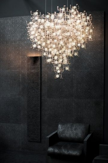 A real work of art by The Dutch artists Lonneke Gordijn and Ralph Nauta of Studio Drift, Sculptural Chandeliers Accented With Real Dandelion Seeds - My Modern Metropolis
