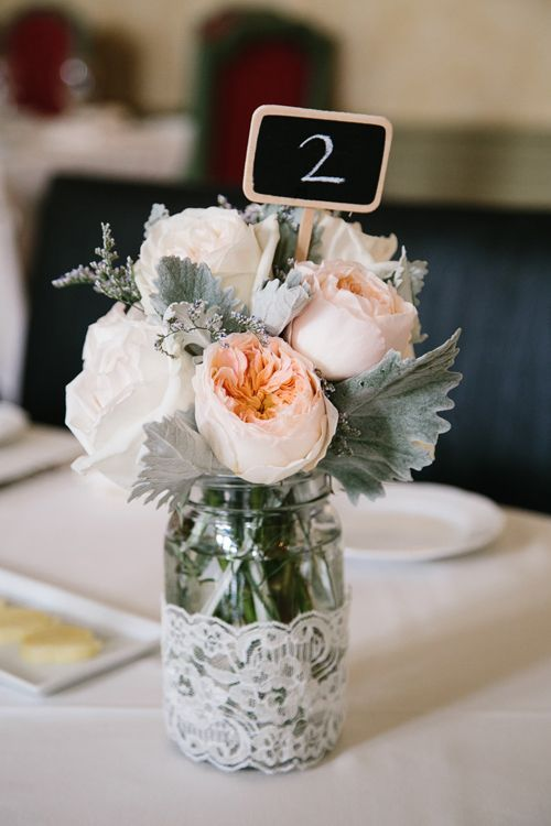 garden rose centerpiece that doubles as table numbers - photo: A Brit and a Blonde