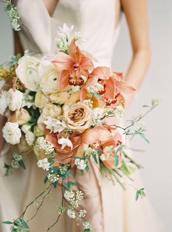 A sherbet bouquet with orchids, roses, and spirea.