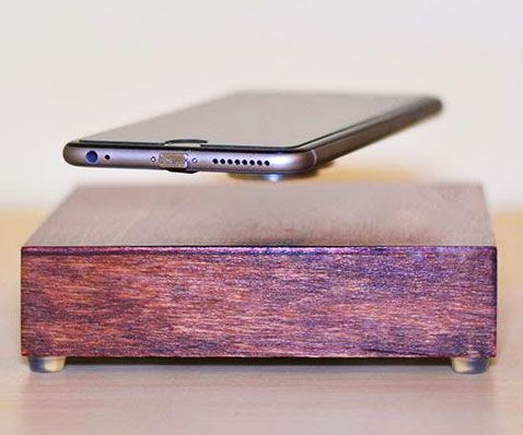 Defy gravity on a daily basis by charging your smartphone using this levitating wireless charger. It sports a sleek wooden base that utilizes a combination of induction charging and magnetic levitation to make your phone float and rotate as it charges.