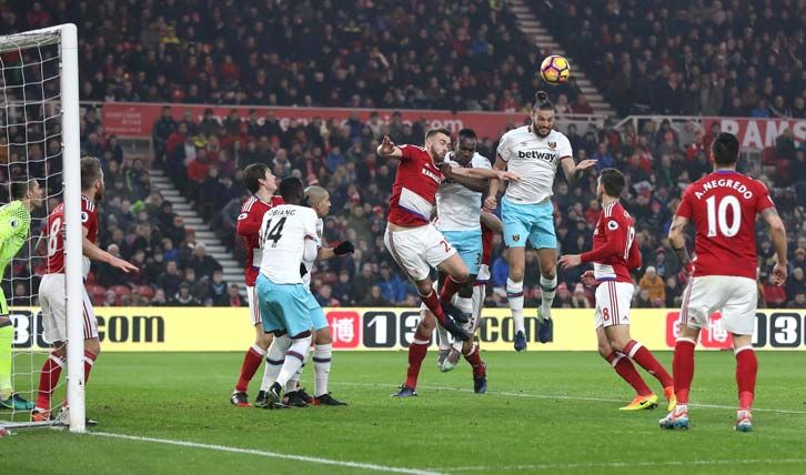 Andy Carroll rises to give the Hammers an early lead