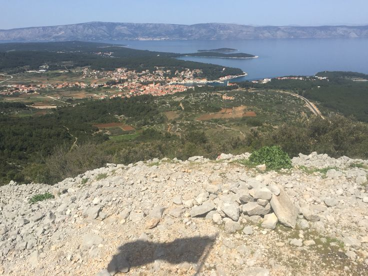 View over town of Jelsa on island of Hvar from ancient Greek fort, Tor, complete with flag shadow.