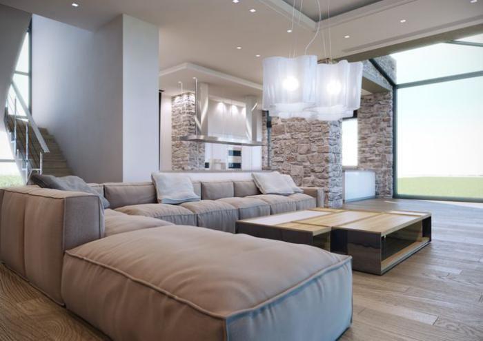 pierre apparente, sofa modulable avec gos matelas beiges dans un salon contemporain