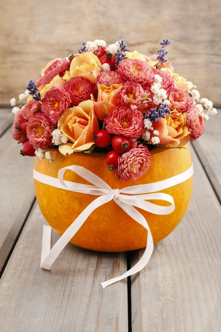 Host a Fall Inspired Birthday Party | Beautiful pumpkin flower bouquet with autumn colors. Just gorgeous!
