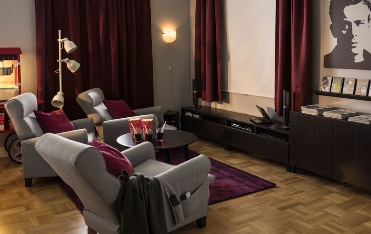 A living room (or spare bedroom) is styled as a home movie theater.