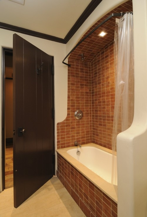 Different. I love the big dark wood door and the tiles in the shower. For a guest bathroom.
