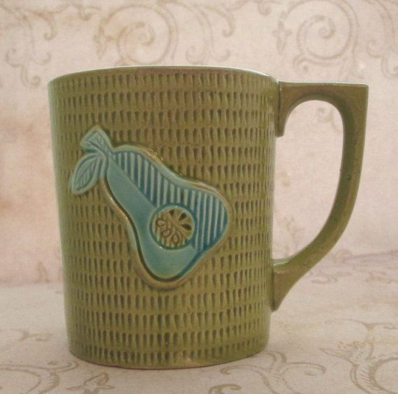 """cute vintage 1960s green ceramic 3.5"""" coffee mug with pretty turquoise pear motif - fabulous colours / glazing / design on both sides  add a retro flare to your morning cup of hot coffee  Size - 3.5"""" tall x 3"""" across at top Capacity - 8oz Weight - 173gms Origin - Made in Japan Circa - 1960s/70s Condition - excellent  .. curated especially for your vintage home .. - $7.00"""