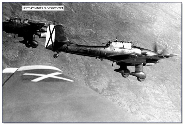 Spain - 1939. - GC - German Stuka Dive bombers fly over the Spanish skies. May 30, 1939. It has cross markings of Franco's Nationalist Air Force. Germany had sent the Condor Legion to help Franco. For Hitler it was arms testing.