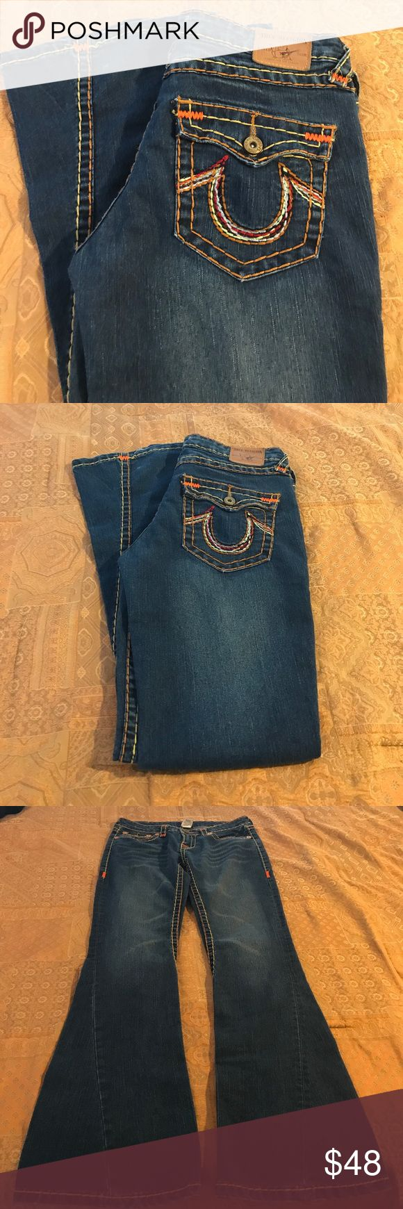 Sale True religion size 31 True Religion twisted joey size 31. Hem from the knee down twists in the front super cute and in great condition. Previously loved just not for me. Inseam 33 waist laying flat 16. Front rise 8 back rise 12.5. Bottom hem 10.5 slim through legs. Slight wear on hem True Religion Jeans
