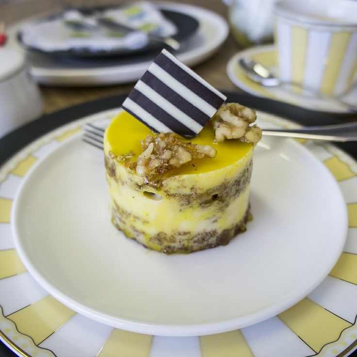 Playful cake served on Noritake's Marc Newson by Noritake, Carnivale Yellow and Colorwave Graphite plates. Don't be shy to layer multiple plates and mix & match!